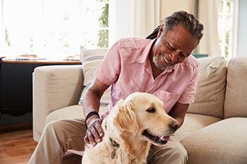 Older Man Petting a Dog